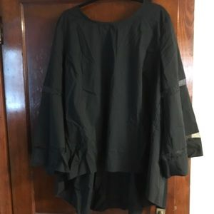 Black blouse with bell sleeves and sheer details.